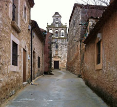 narrow Spanish street with bell tower