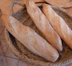 loaves of bread in an esparto woven basket