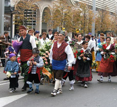 people parading in traditional Spanish dress