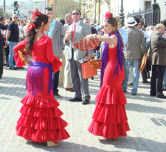 women wearing traditional feria dresses
