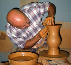 potter making a vase on a pottery wheel