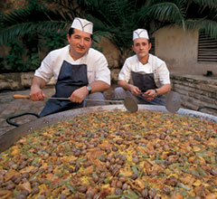 two men with a giant paella