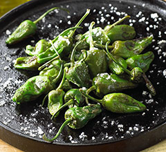 plate of sauteed padron peppers sprinkled with sea salt