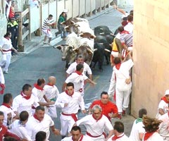 people and bulls in the streets of Pamplona