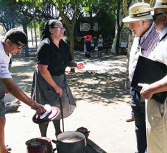 people cooking cocido stew outdoors