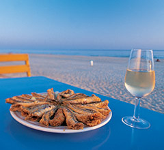 plate of fried boquerones at the seaside
