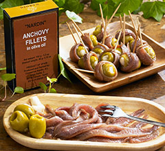 anchovy fillets on plate and wrapped around olives