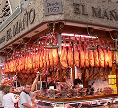 hams hanging in the market