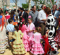 people in traditional dress at a feria