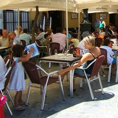 families sitting at an outdoor cafe