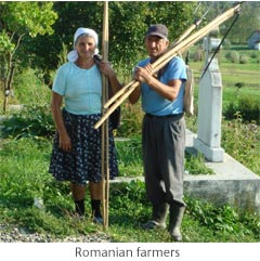 Romanian farmers with farm implements