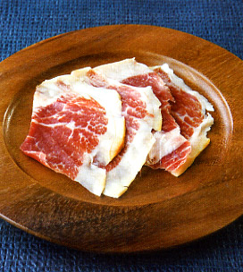 wooden plate of thinly sliced ibérico de bellota ham