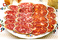 plate of sliced Iberico sausage